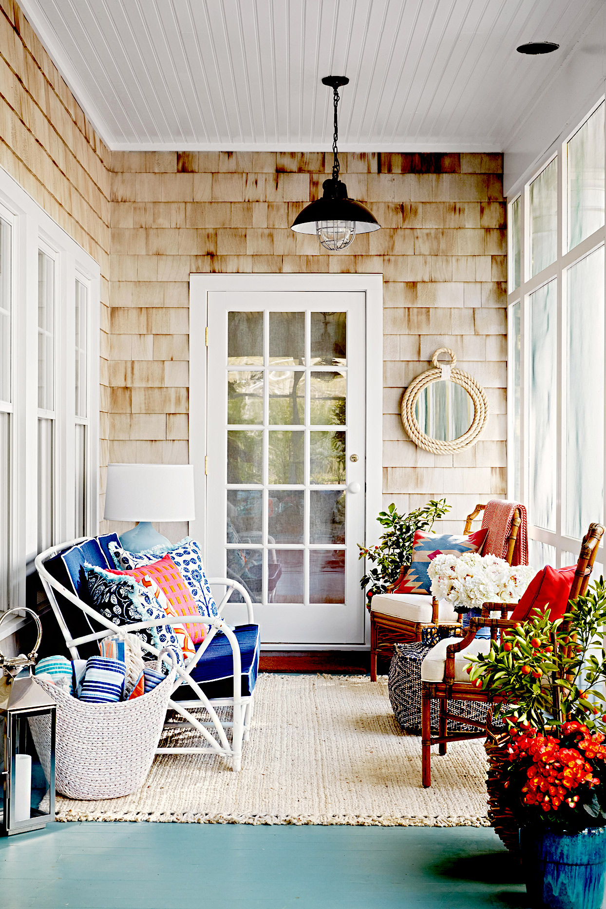 Porch with couch, wicker chairs
