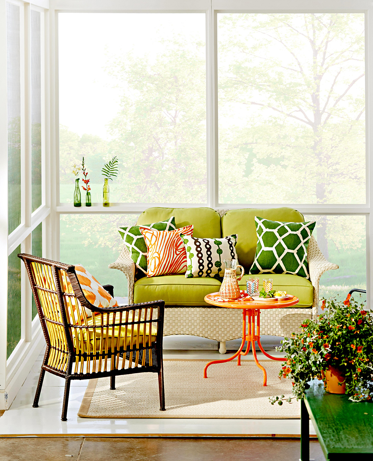Porch windows, couch, chair, small table