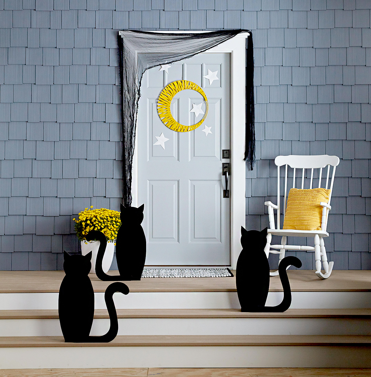 Doorway with Halloween décor, cats, moon, stars