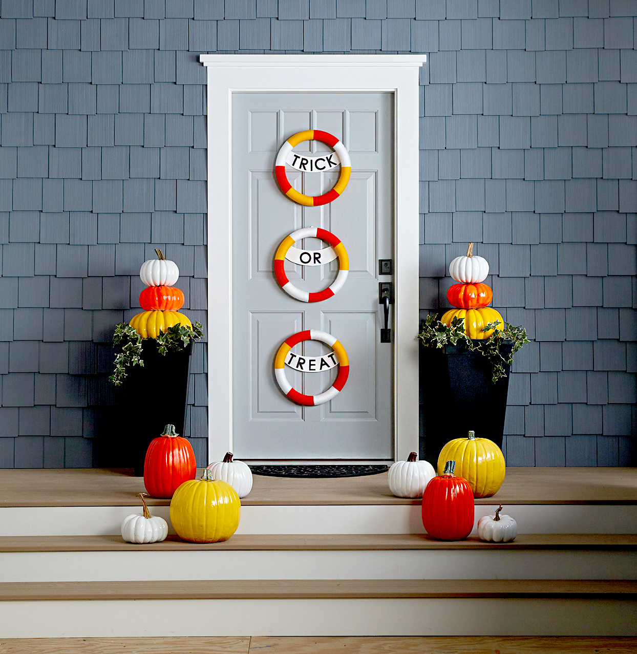 Doorway with Halloween décor, pumpkins, Trick or Treat sign