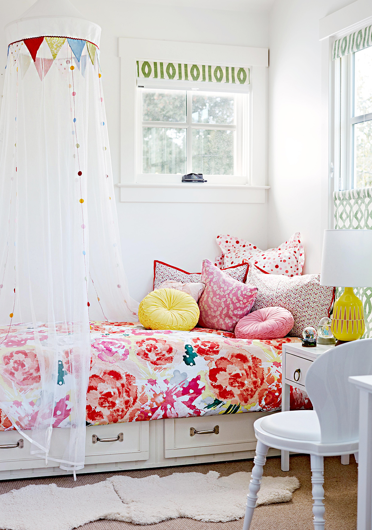 Bed with floral bedspread and netting