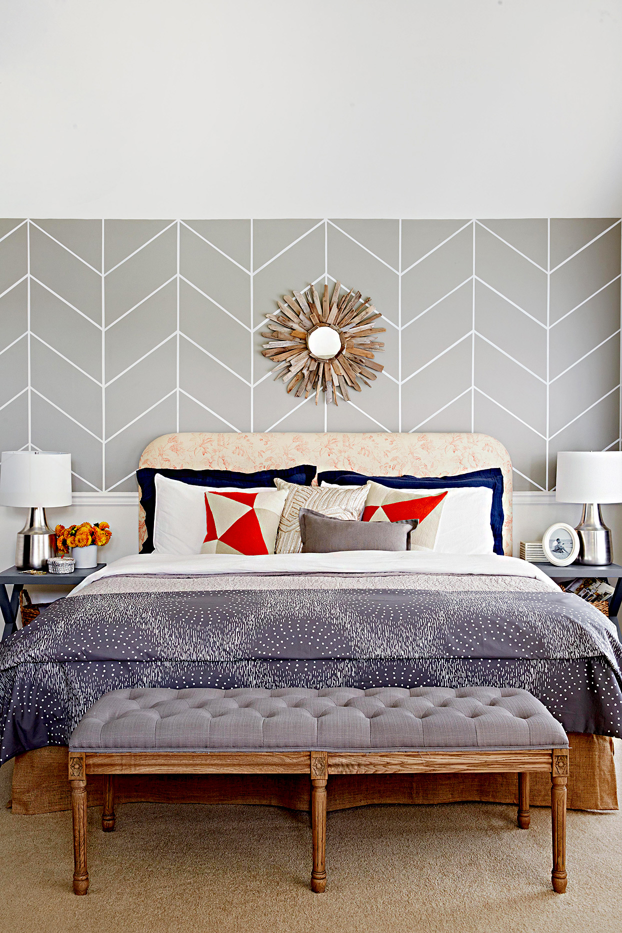 Bedroom with geometric gray walls and gray bedspread