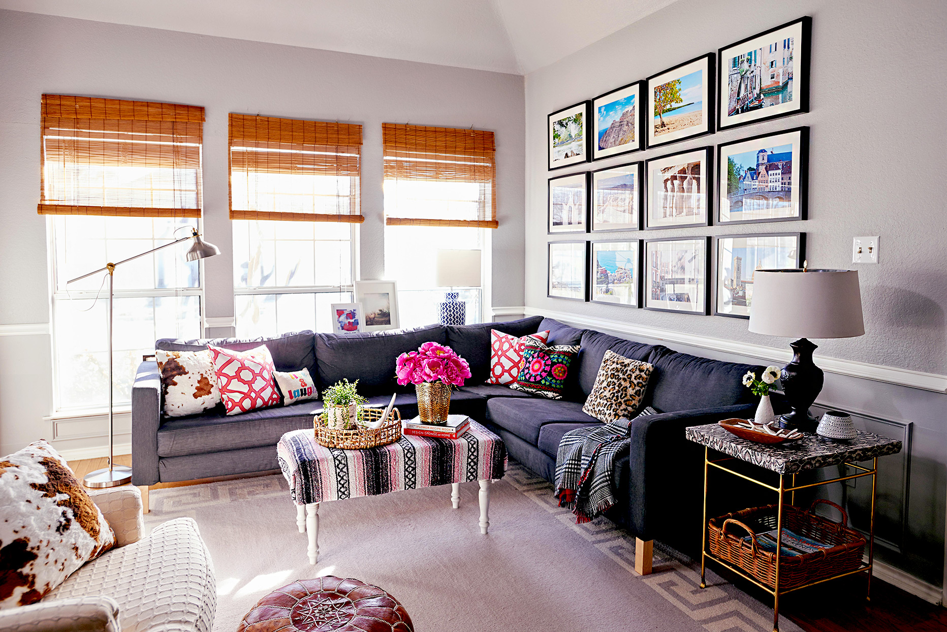 Living room with photographs hanging behind couch