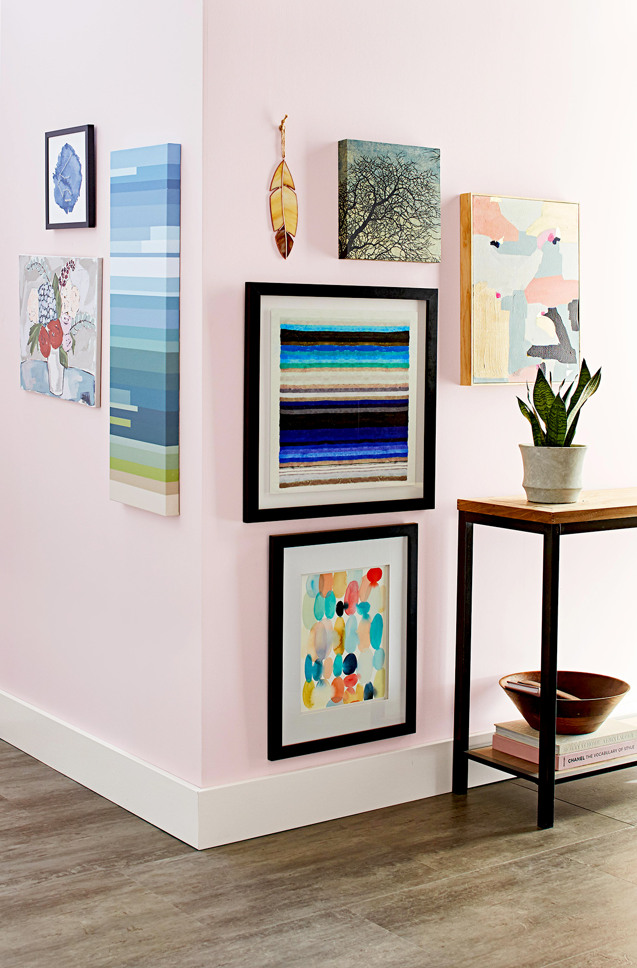 Corner of room with colorful artwork on walls