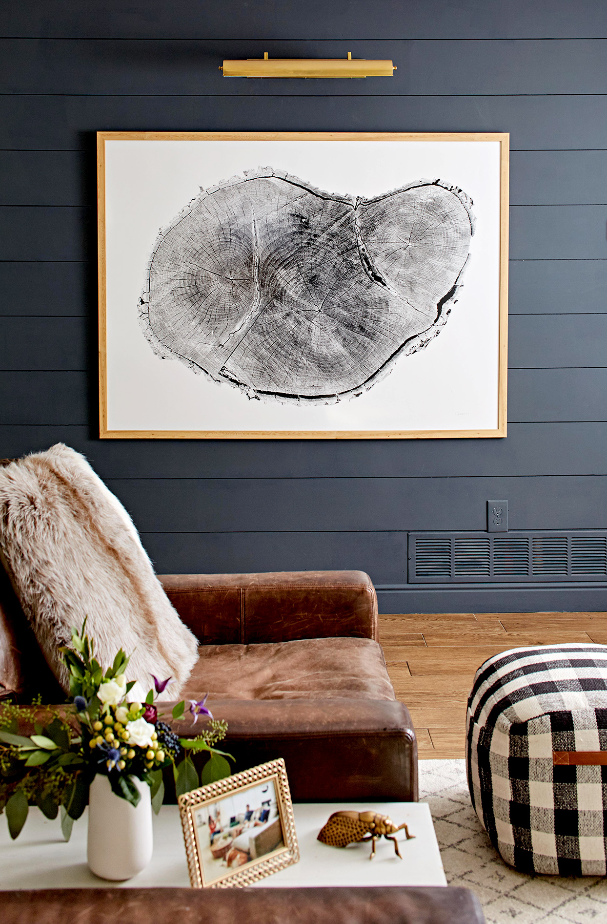 Large black and white artwork next to chair