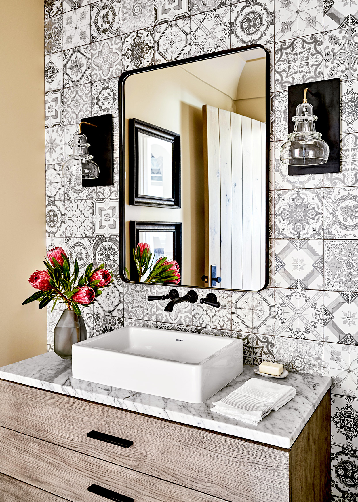 Bathroom with black and white tile and marble sink