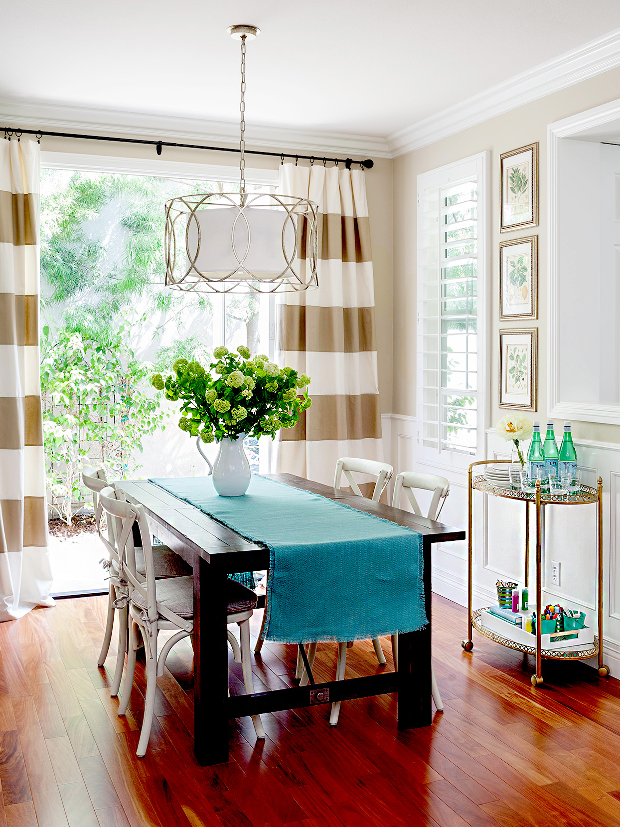 Dining room with dark wood table with blue runner