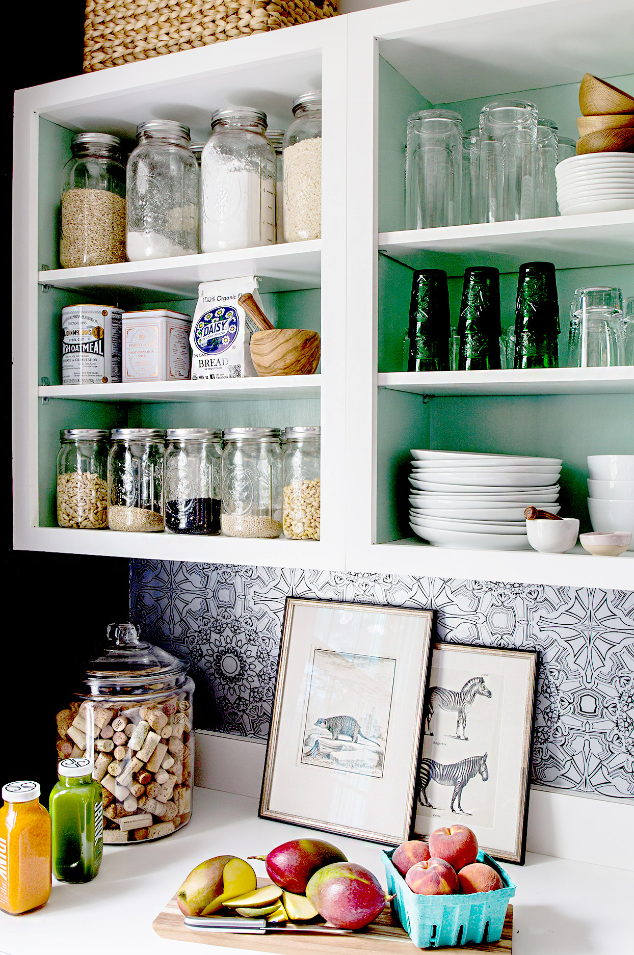 Kitchen shelving with organized dishes and pantry items
