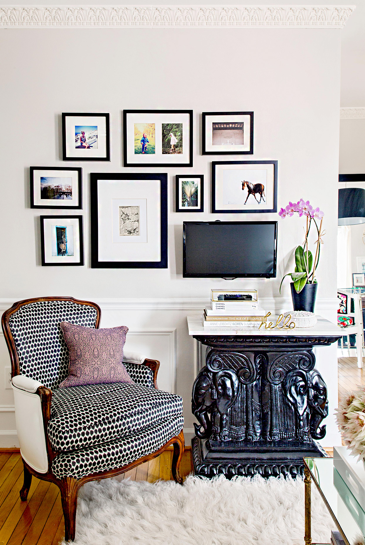 Sitting area with tv and framed artwork on wall