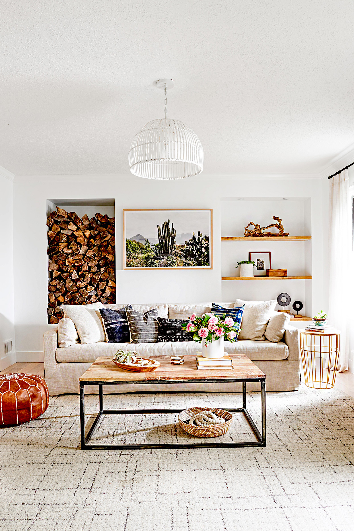 Living room with couch, coffee table, and stored wood