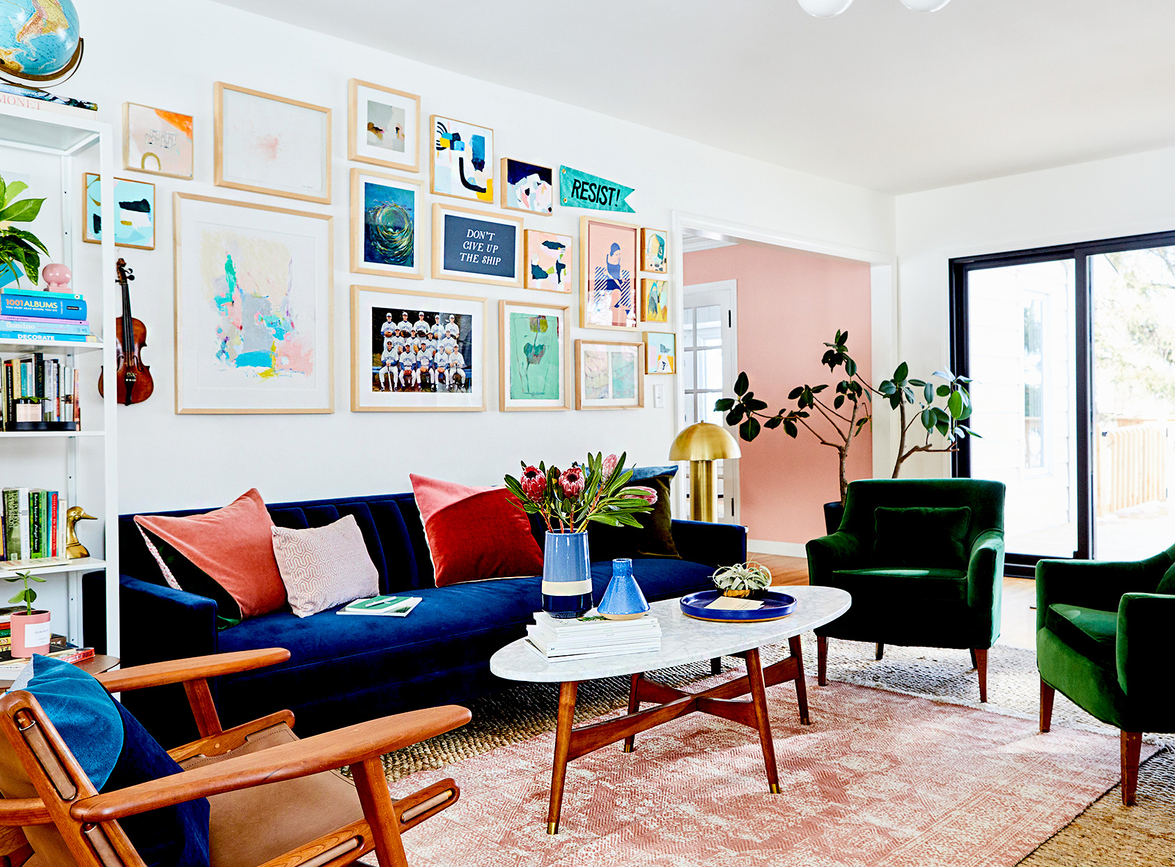 Living room with multiple framed artwork behind couch