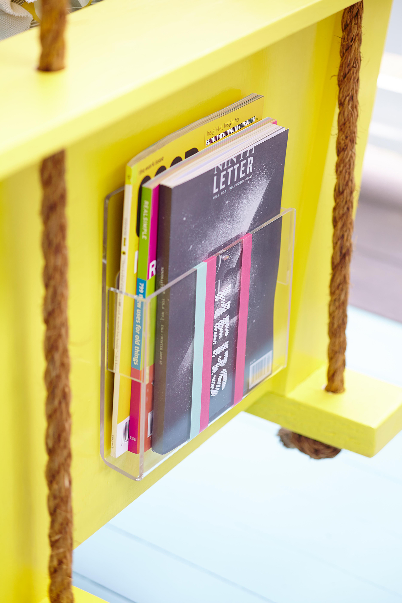 yellow porch swing with diy magazine holder