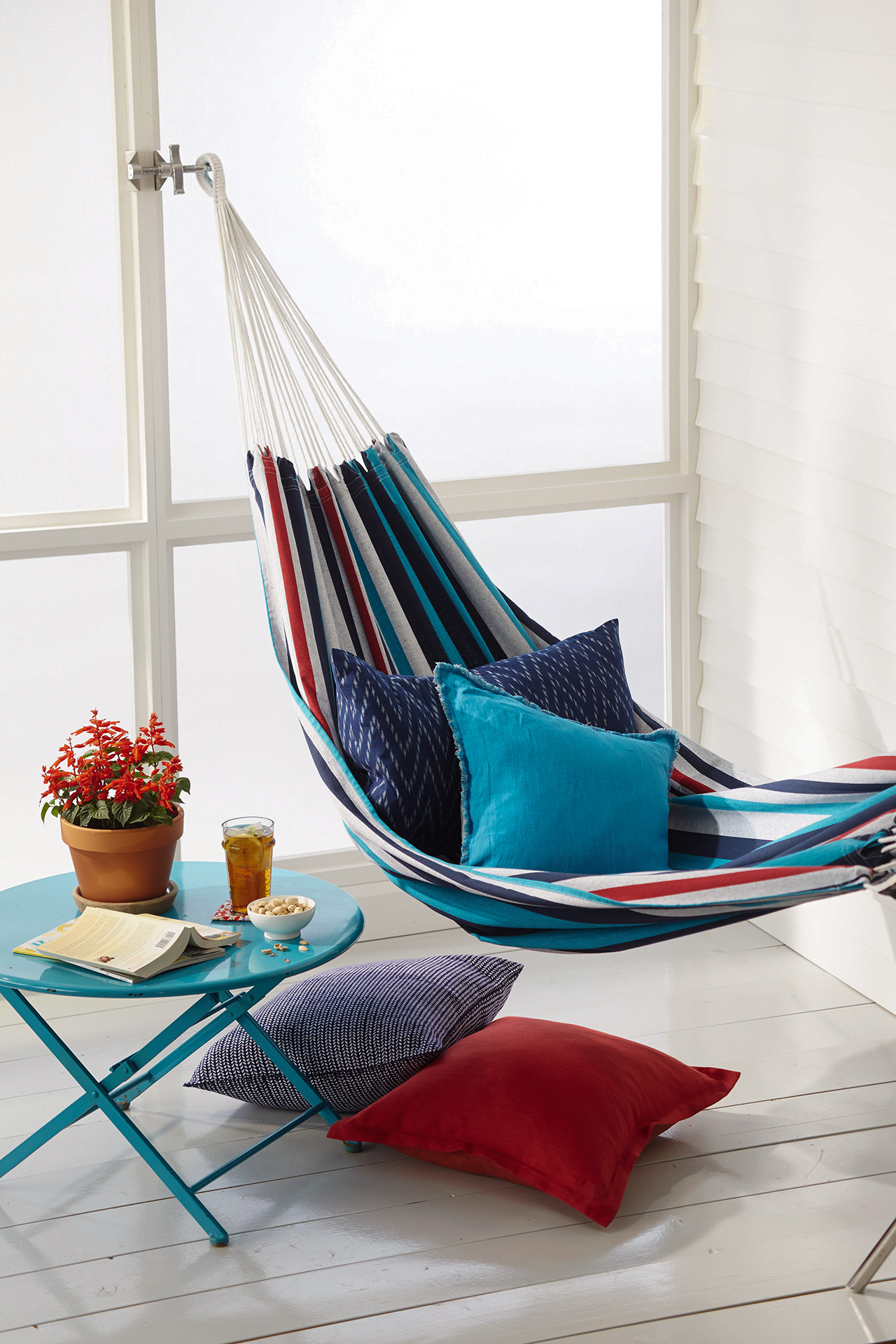 hanging porch hammock with small blue table