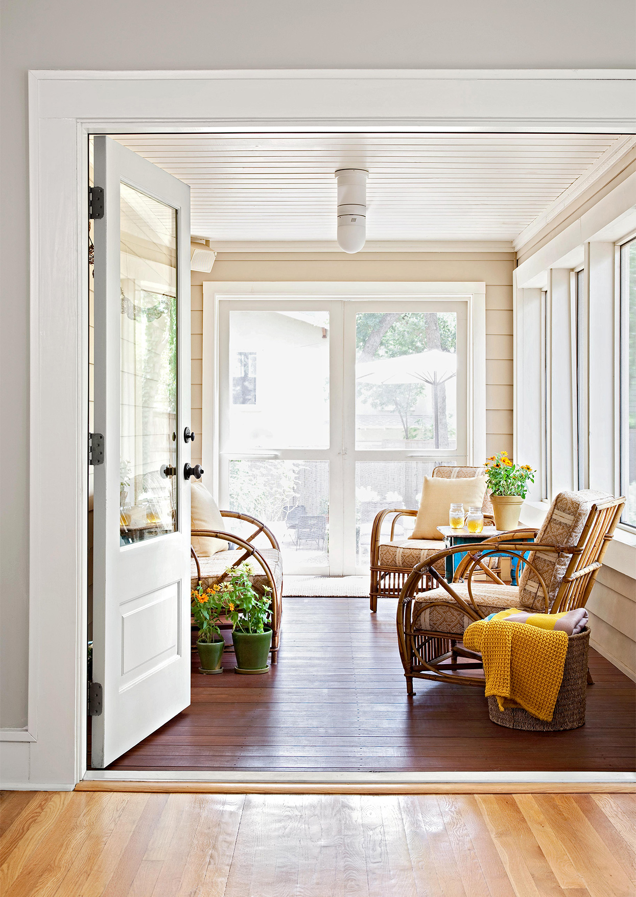 added-on front porch with wicker chairs