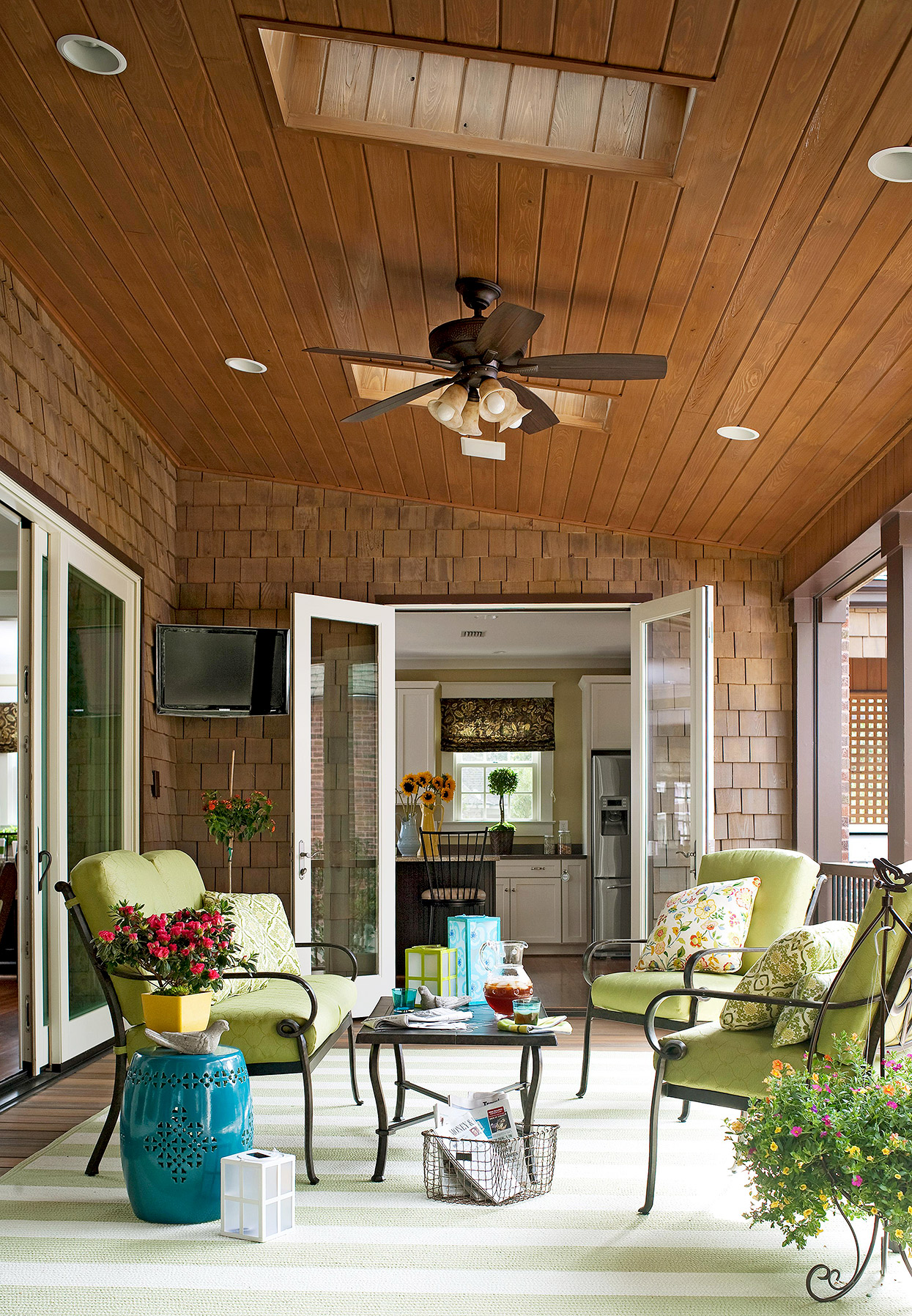 enclosed patio sitting area with slanted ceiling