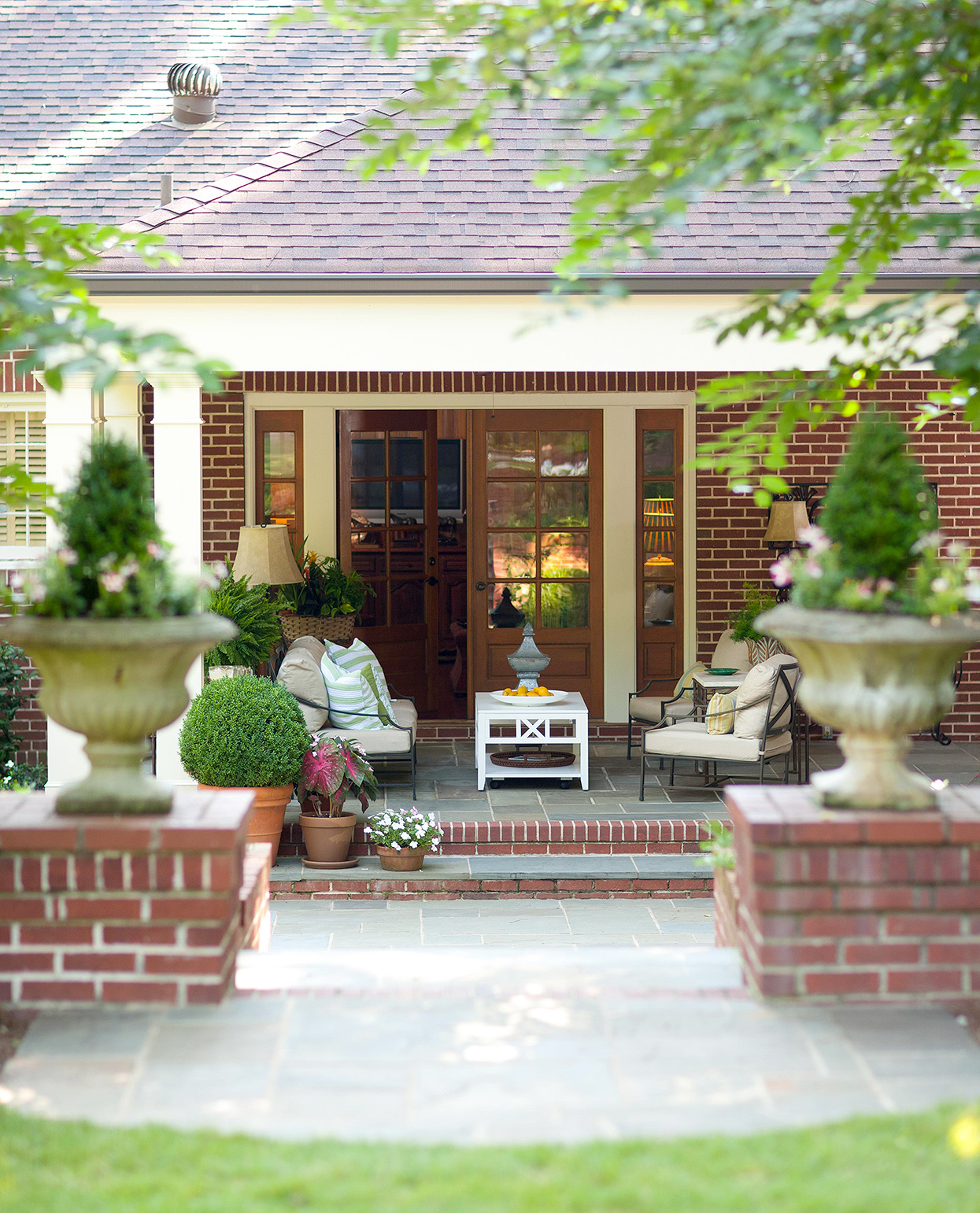 traditional tucked-away patio on brick facade
