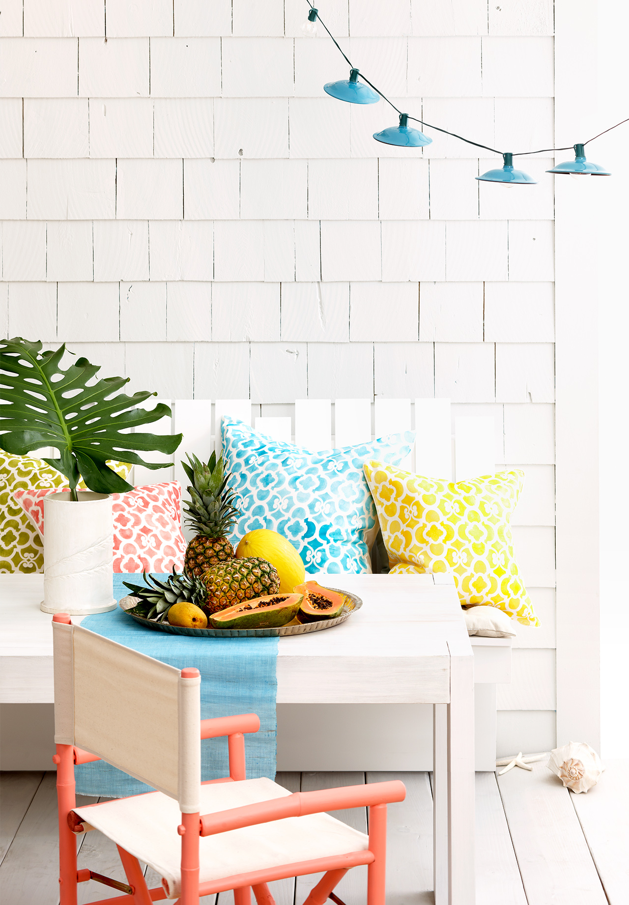 cozy outdoor seating with colorful patterned pillows
