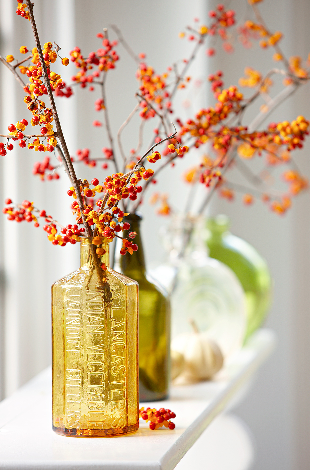 bright berries in old jars for fall display
