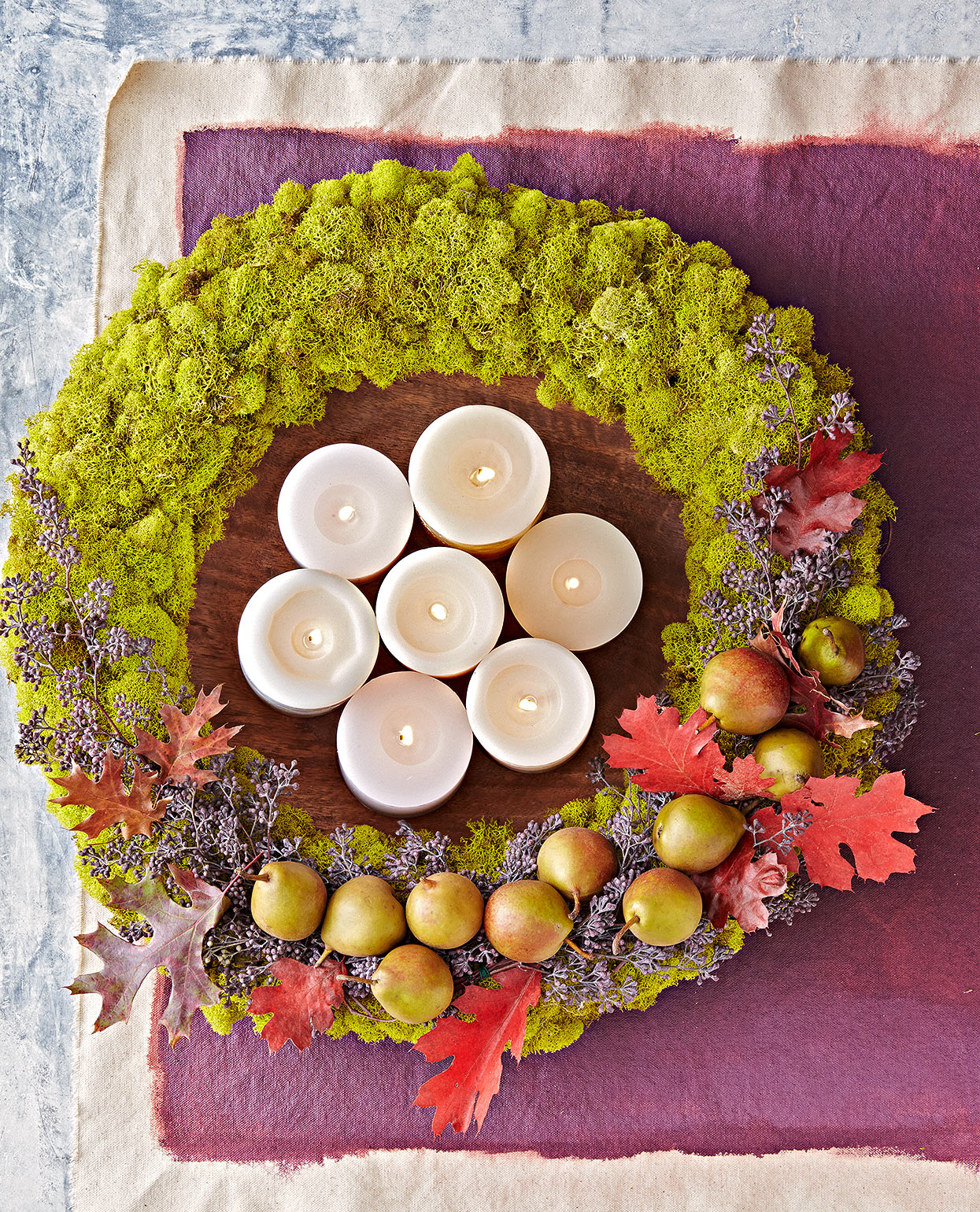 tabletop fall wreath with moss leaves and candles