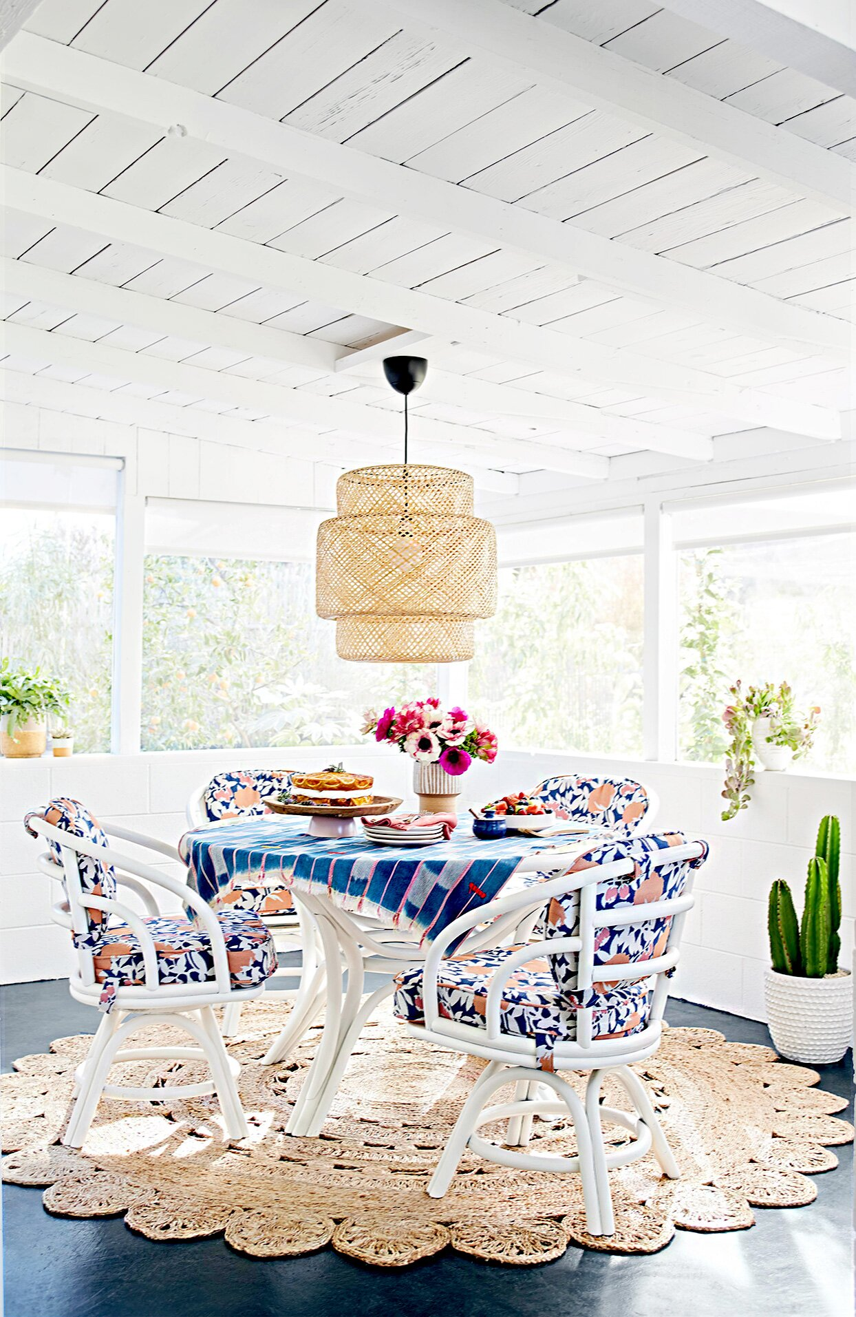 Porch with floral seating and doily rug
