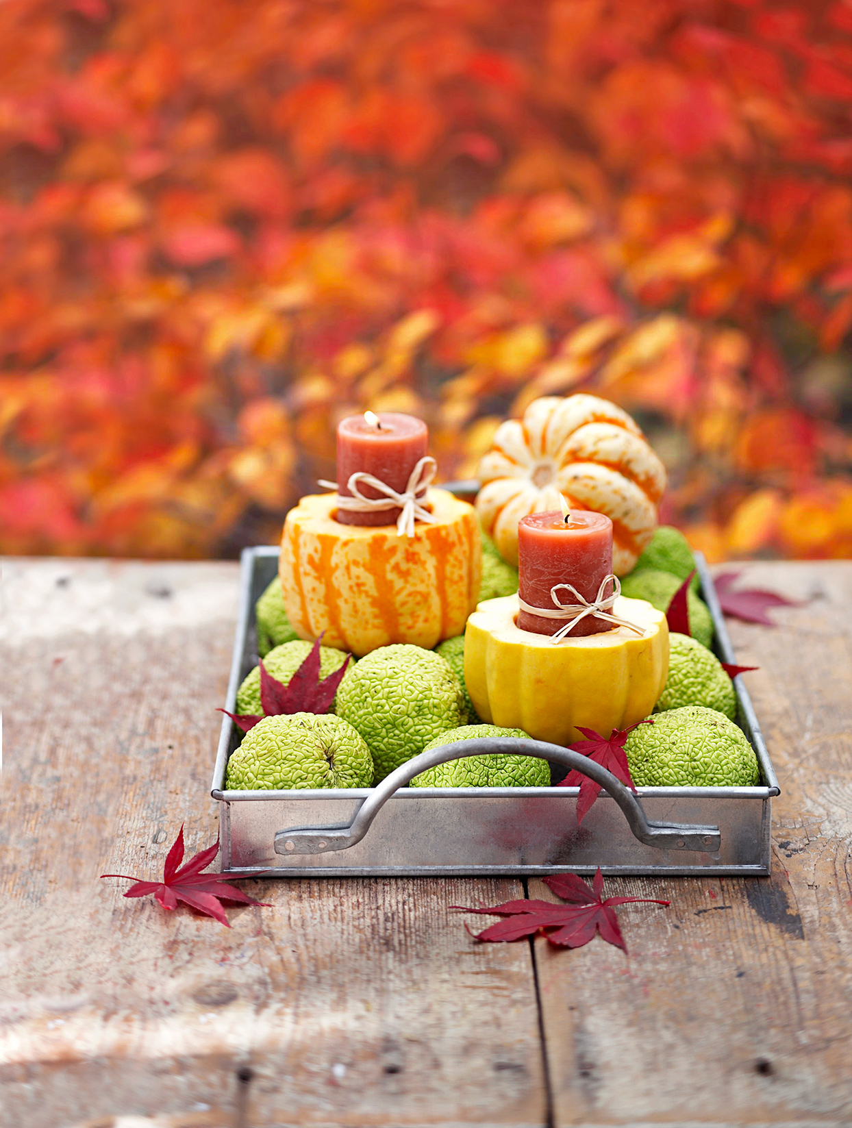 metal tray with gourds and candles