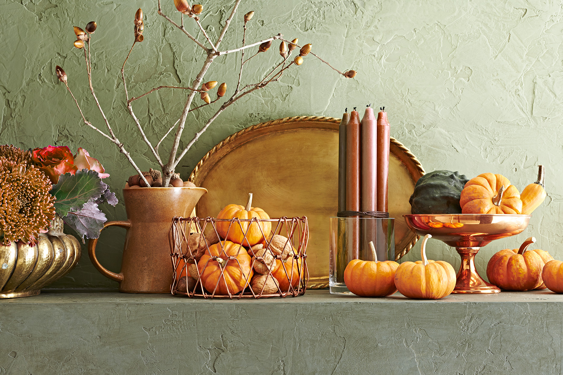 small pumpkins in classic arrangement on shelf