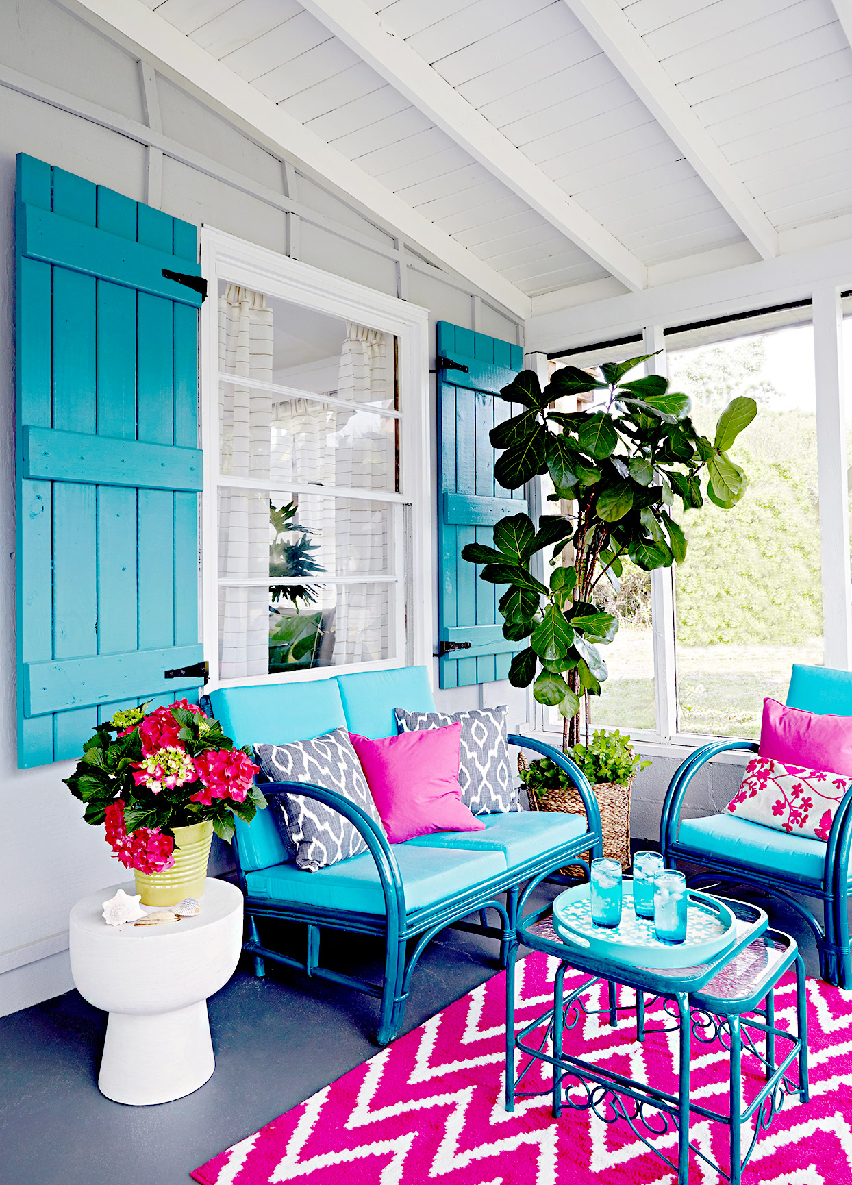 Blue, gray, and purple porch with chevron run and couch