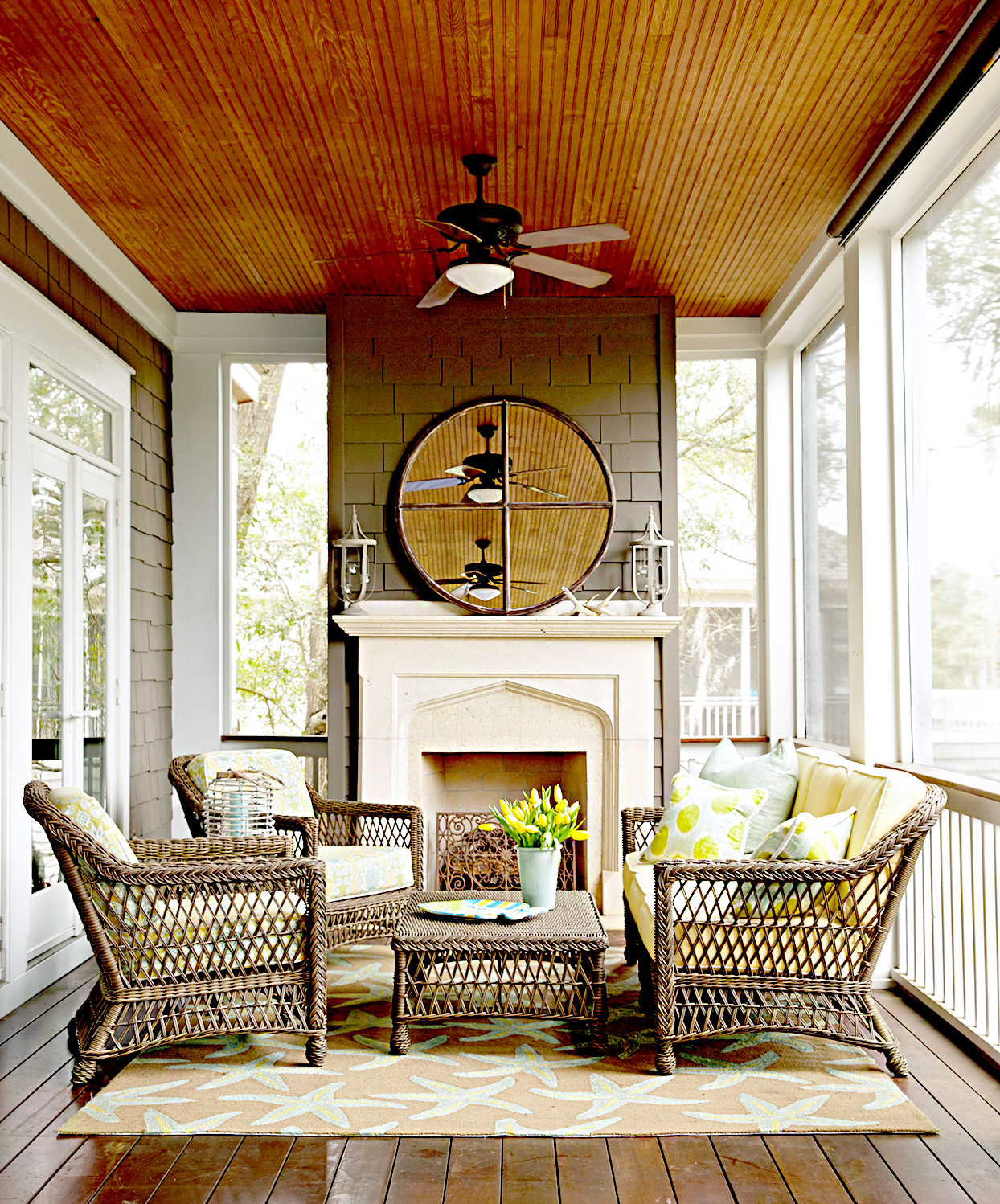 Porch with fireplace and wicker seating