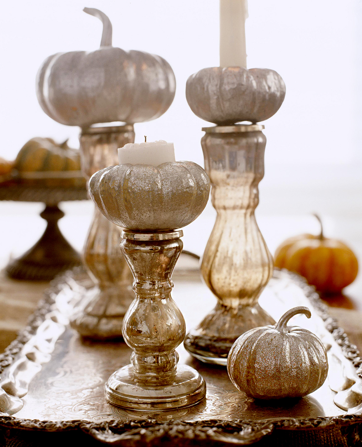 Candleholders with pumpkin toppers