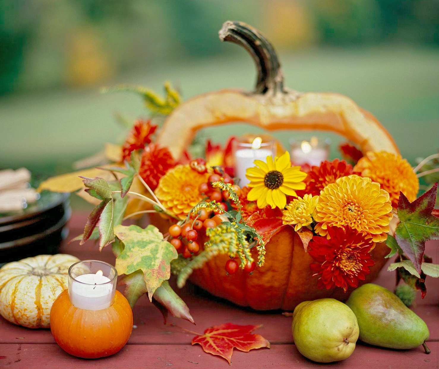 hollowed-out pumpkin with flowers and candles