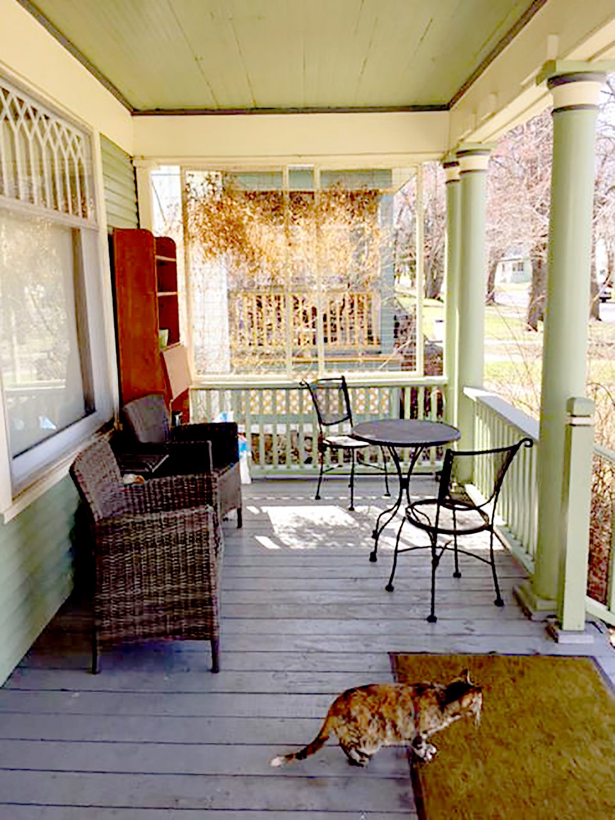 Porch with wicker chairs and small table and chairs