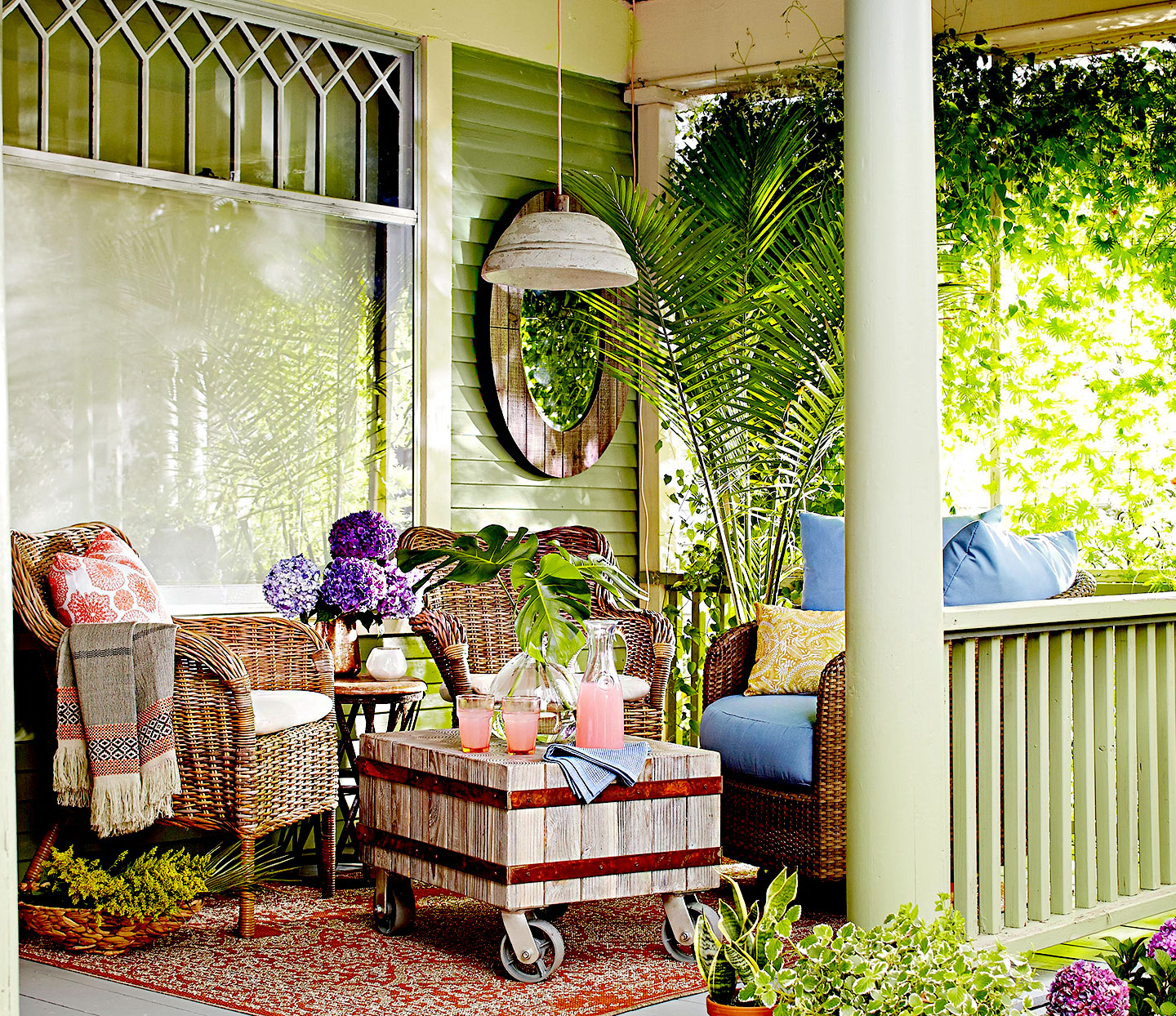 Porch with wicker furniture and rolling coffee table