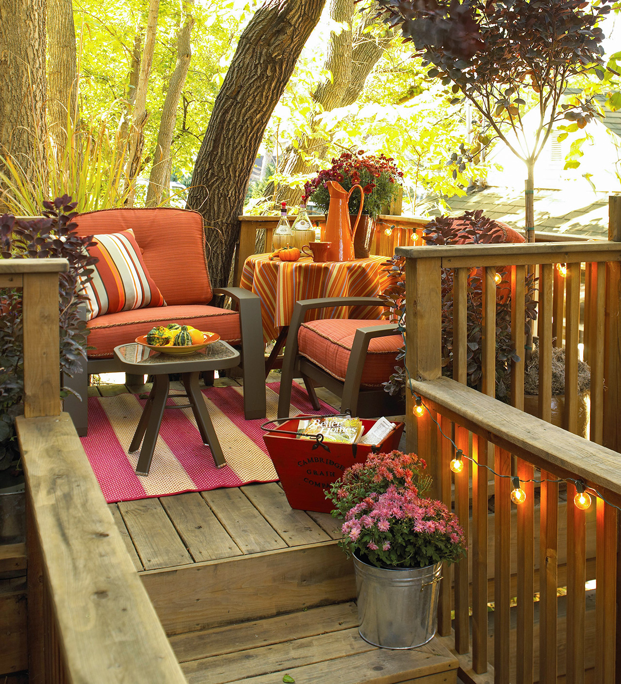 porch deck furniture with fall decor and flowers
