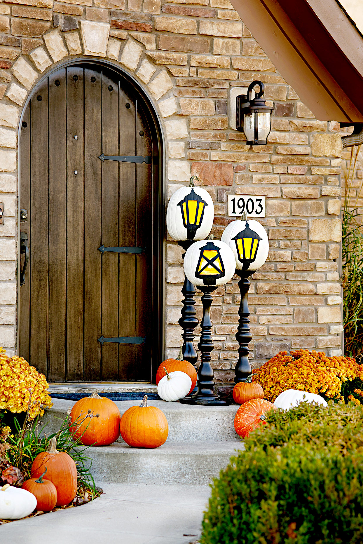 Front porch with pumpkins and painted lights