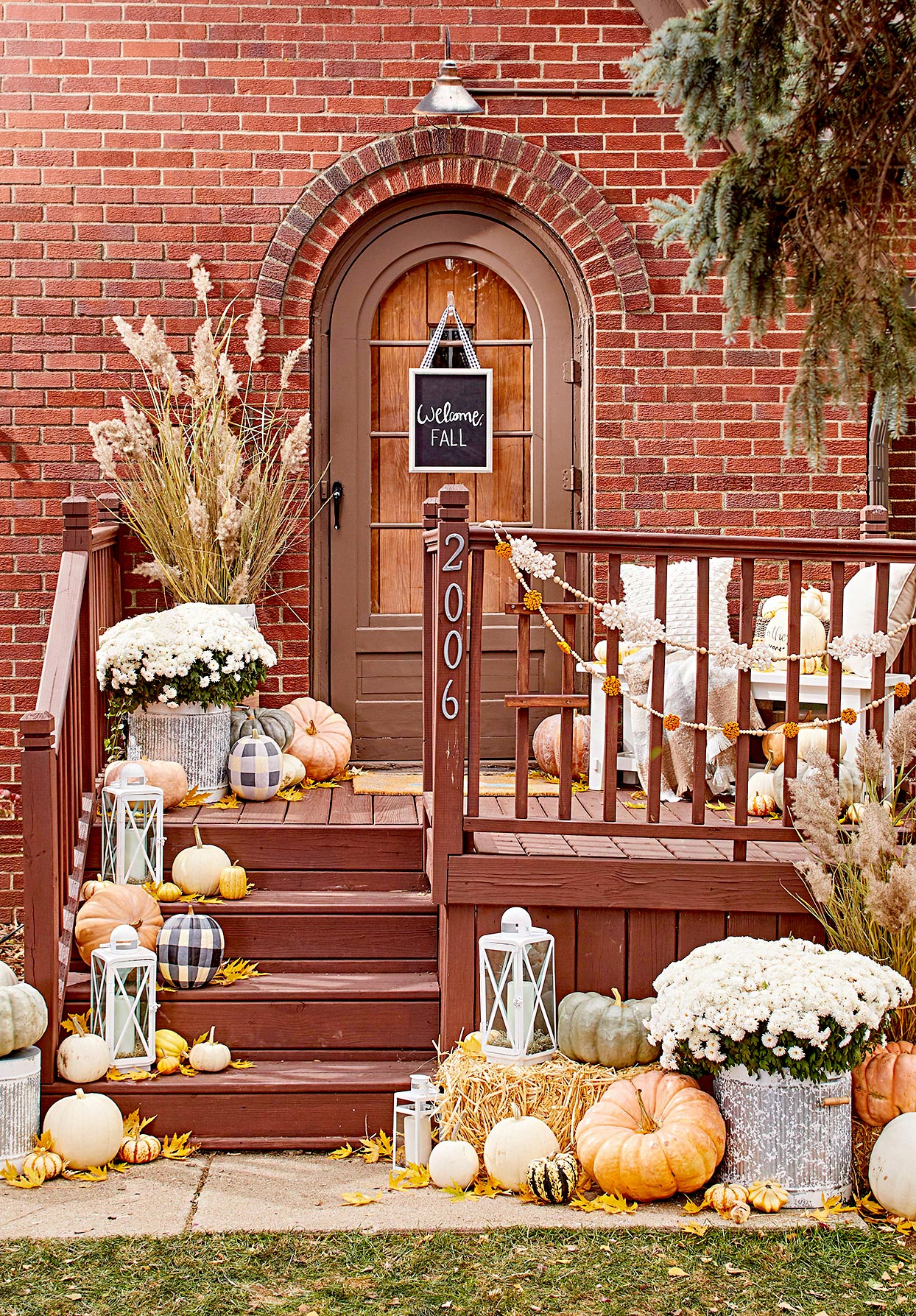 Outdoor Fall Decorating With Mums  from imagesvc.meredithcorp.io