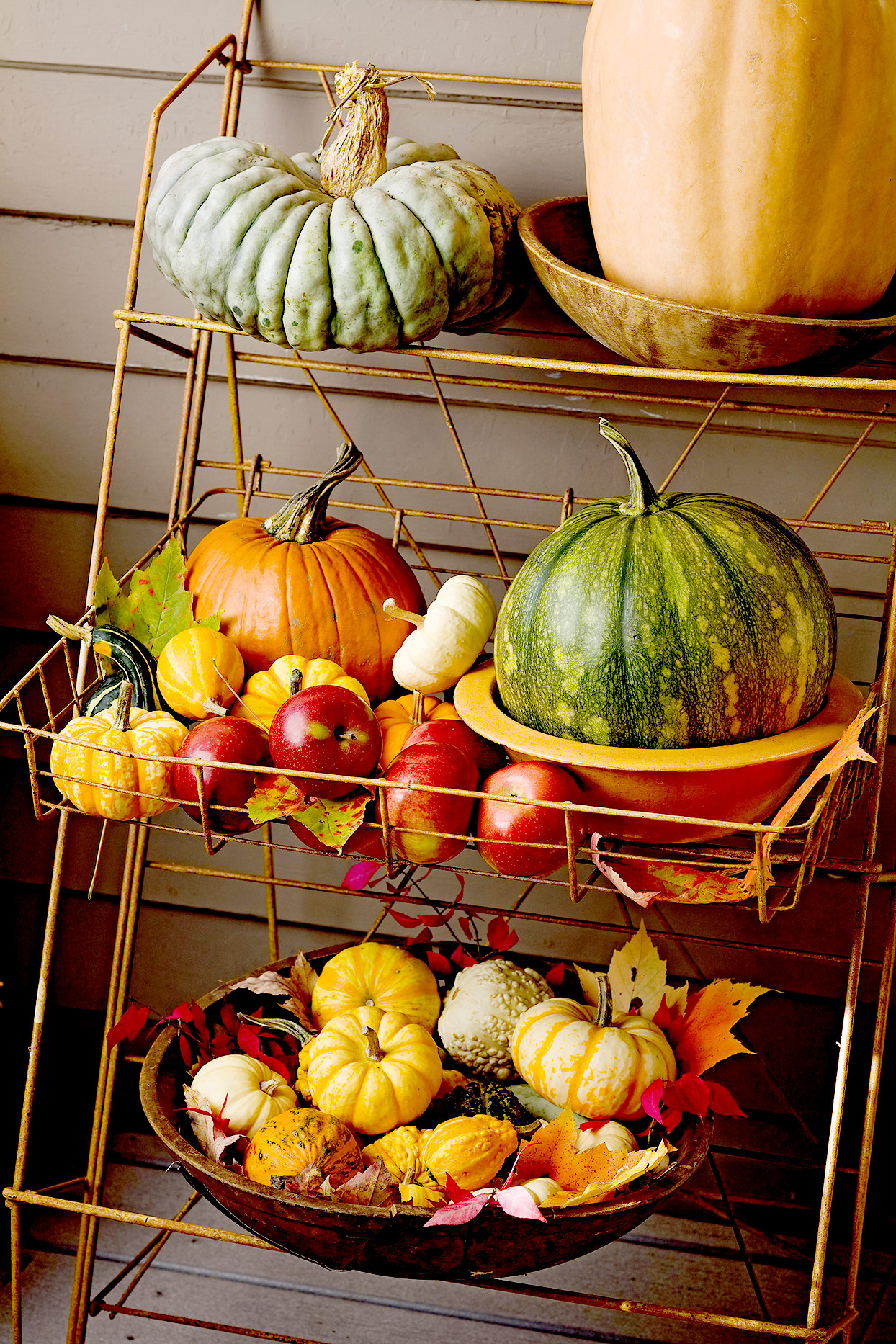 Metal shelving with pumpkins, gourds, and fall décor