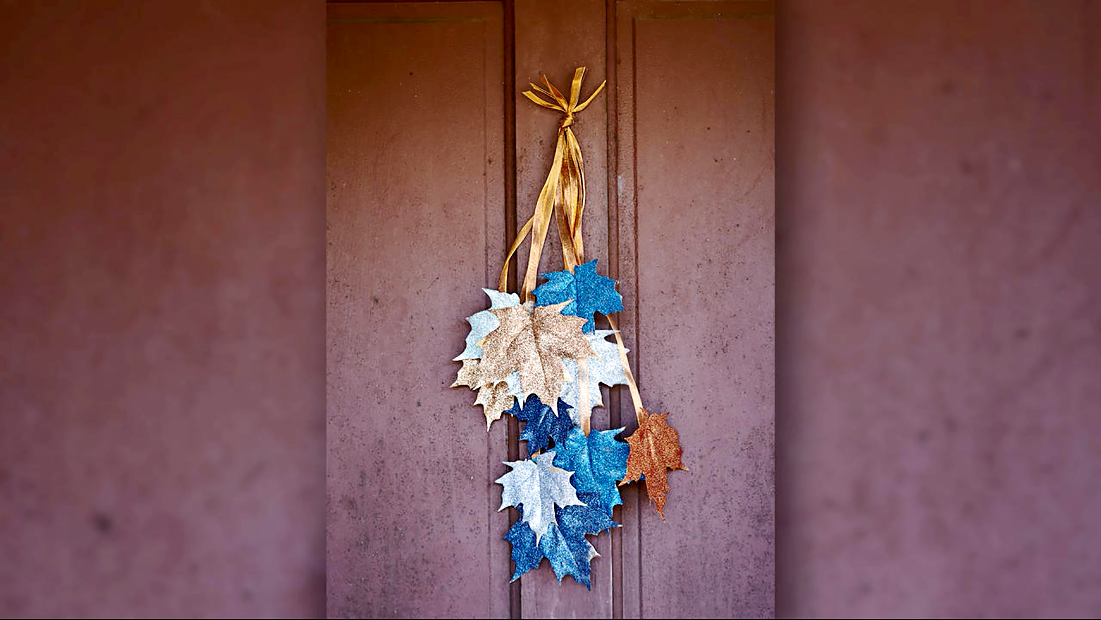 Blue and gold painted hanging leaves