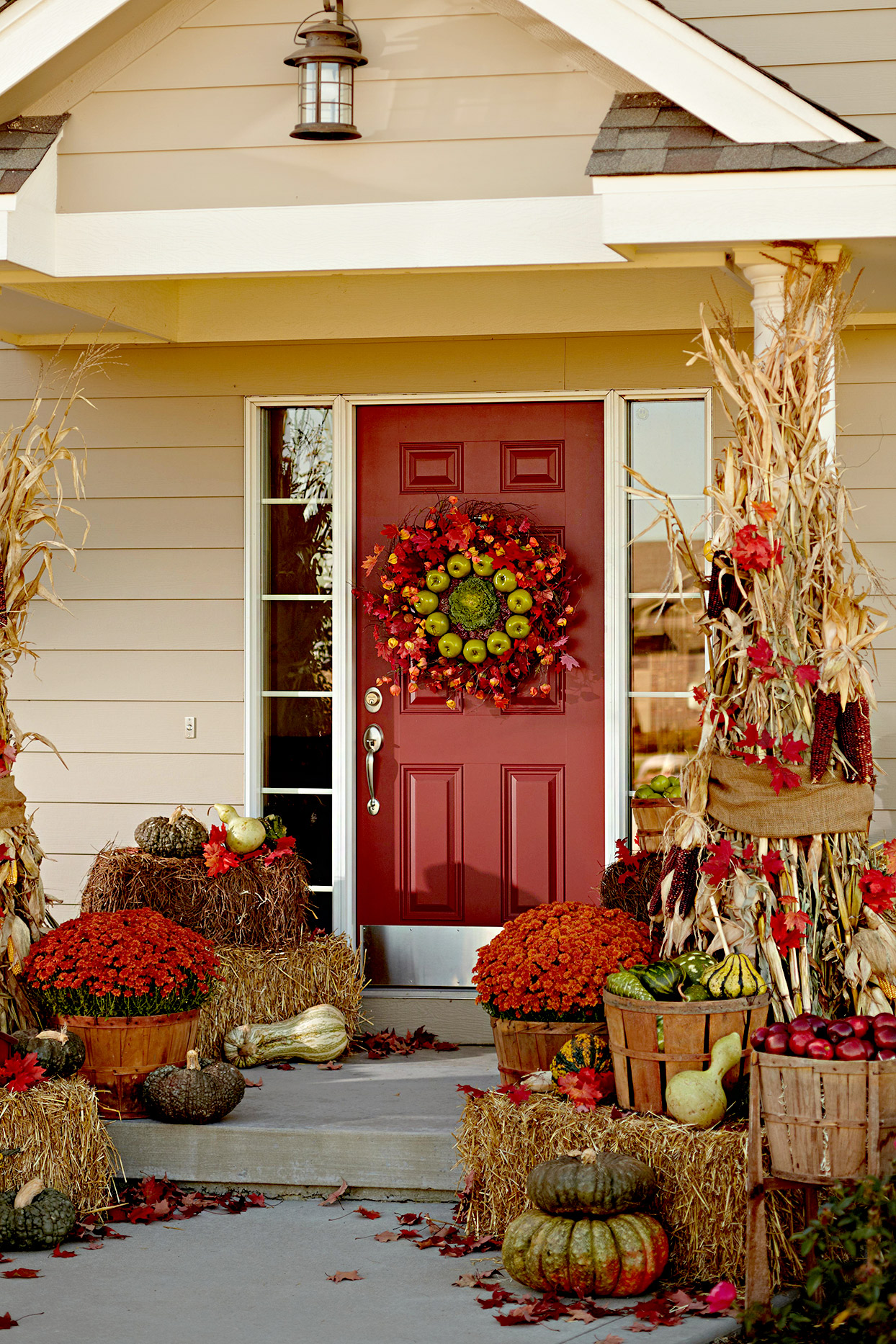 Red front door with large fall wreath