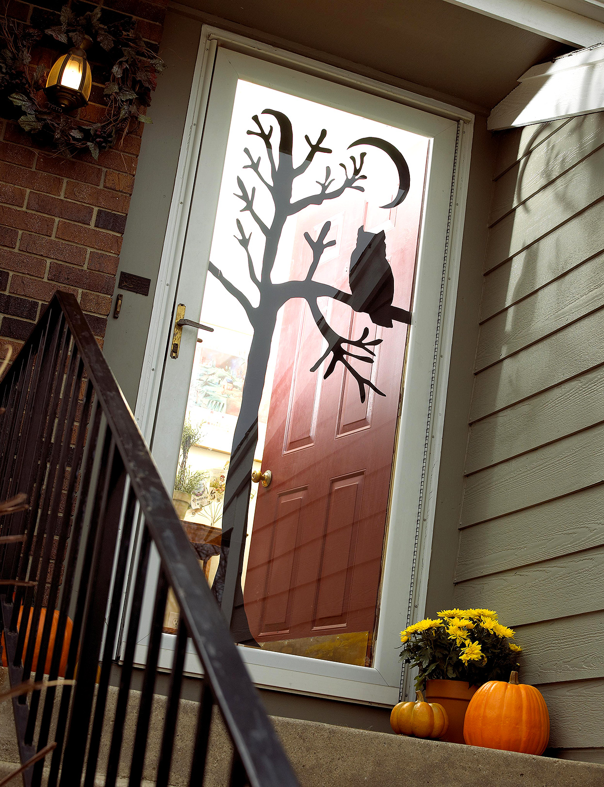 front door with owl and tree silhouettes