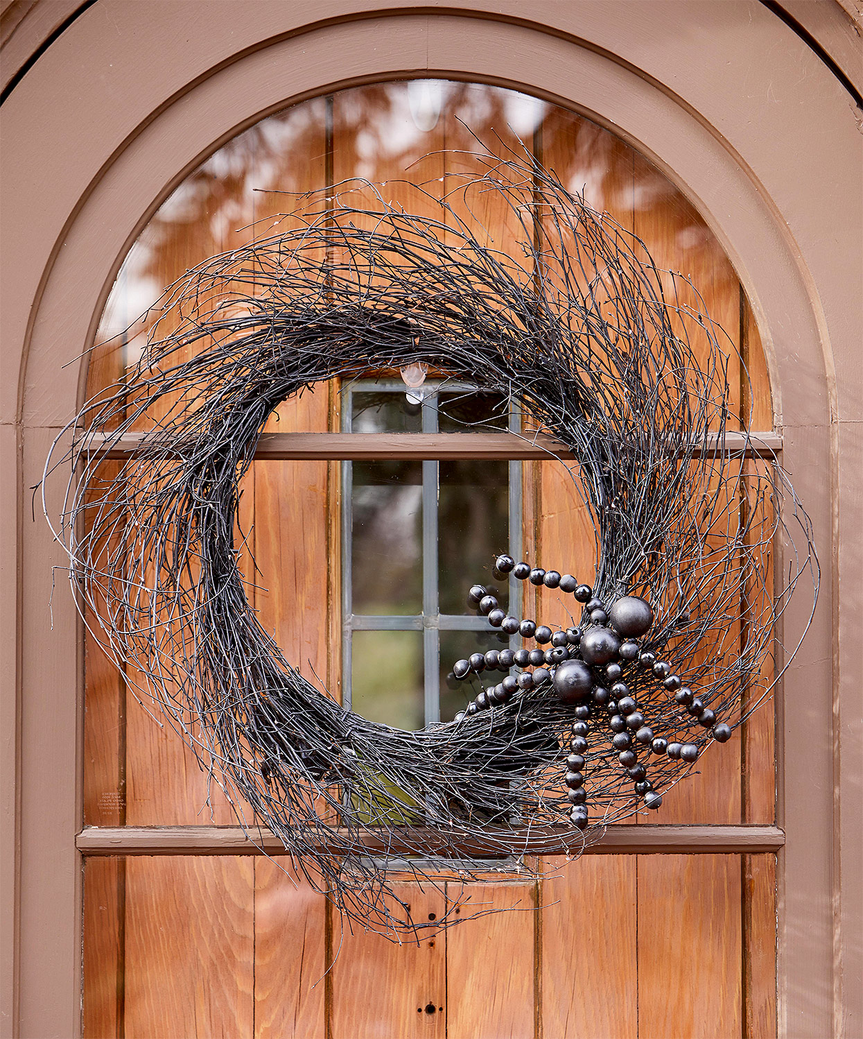 twig wreath with bead spider decor