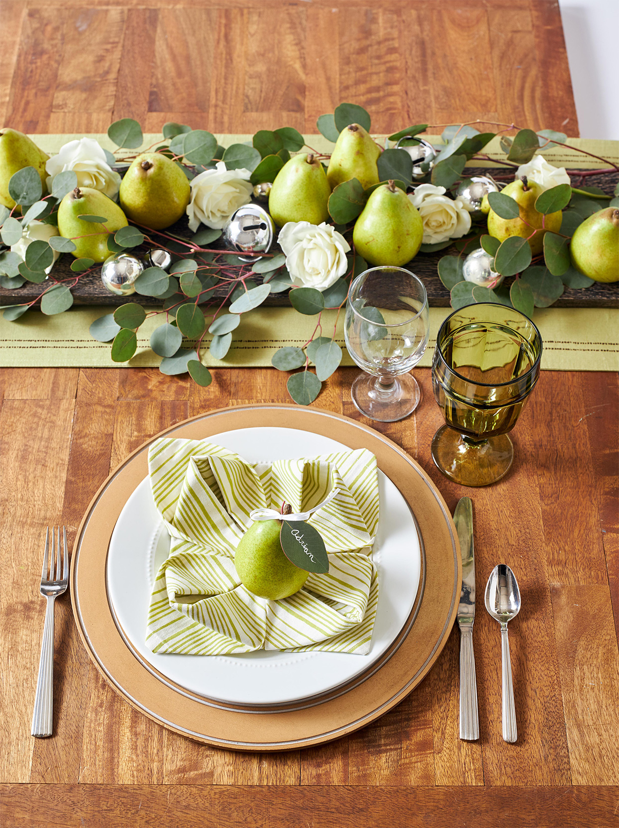green and white place setting decorated with pears