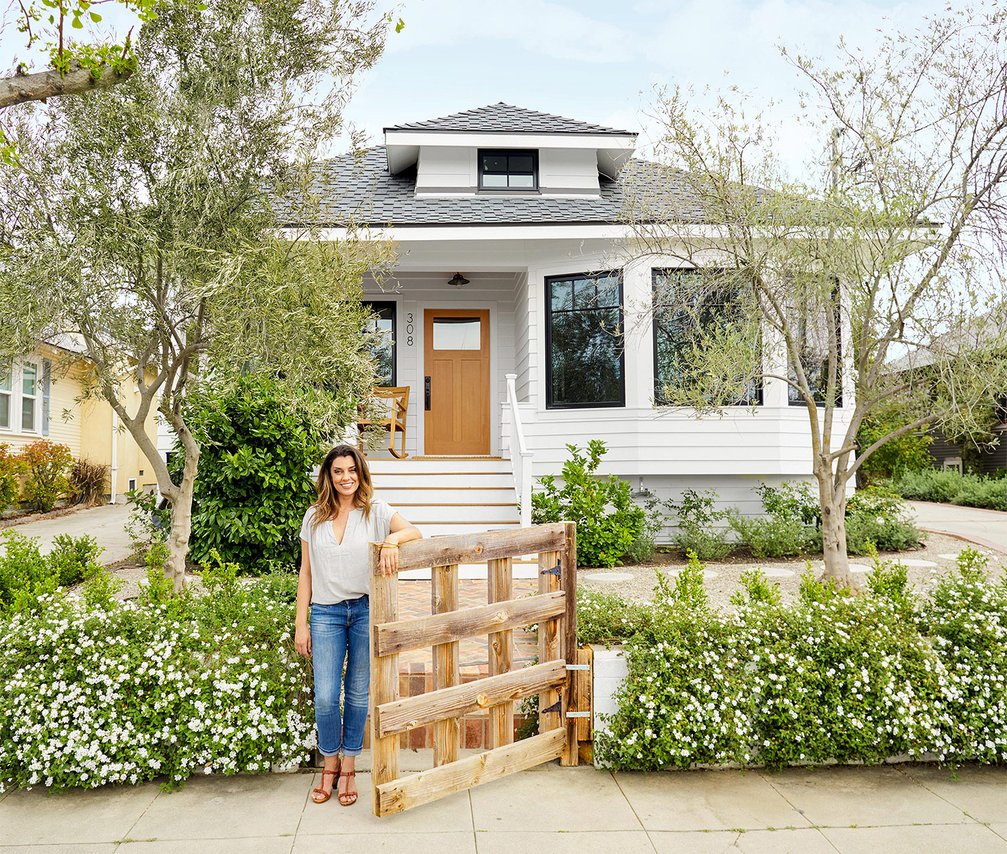 rosa beltran in front of renovated home exterior