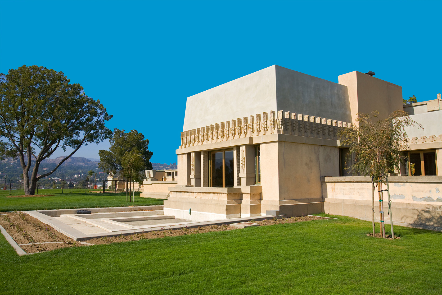 Hollyhock House with blue sky background