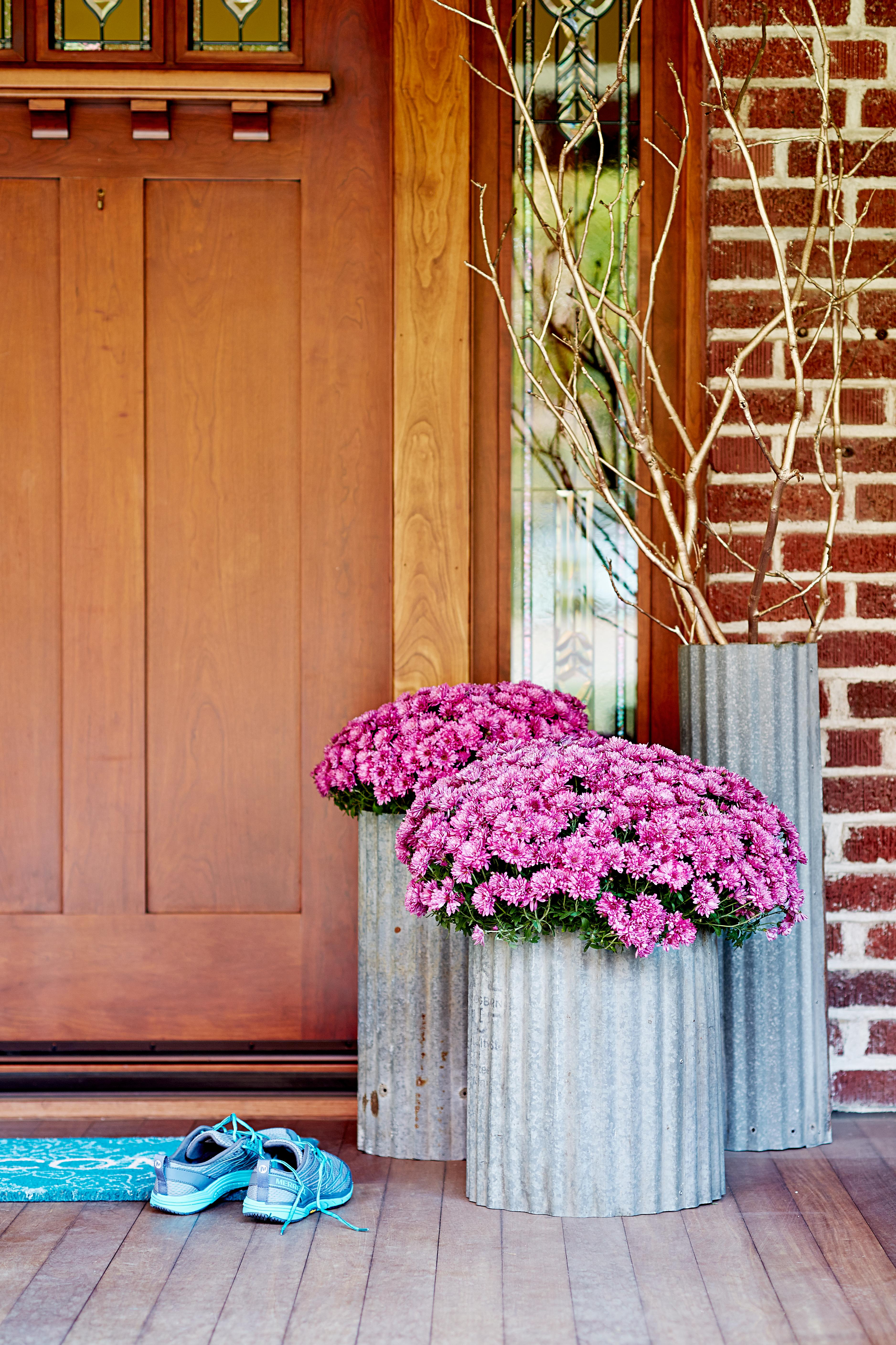 galvanized metal planters with pink mums front porch