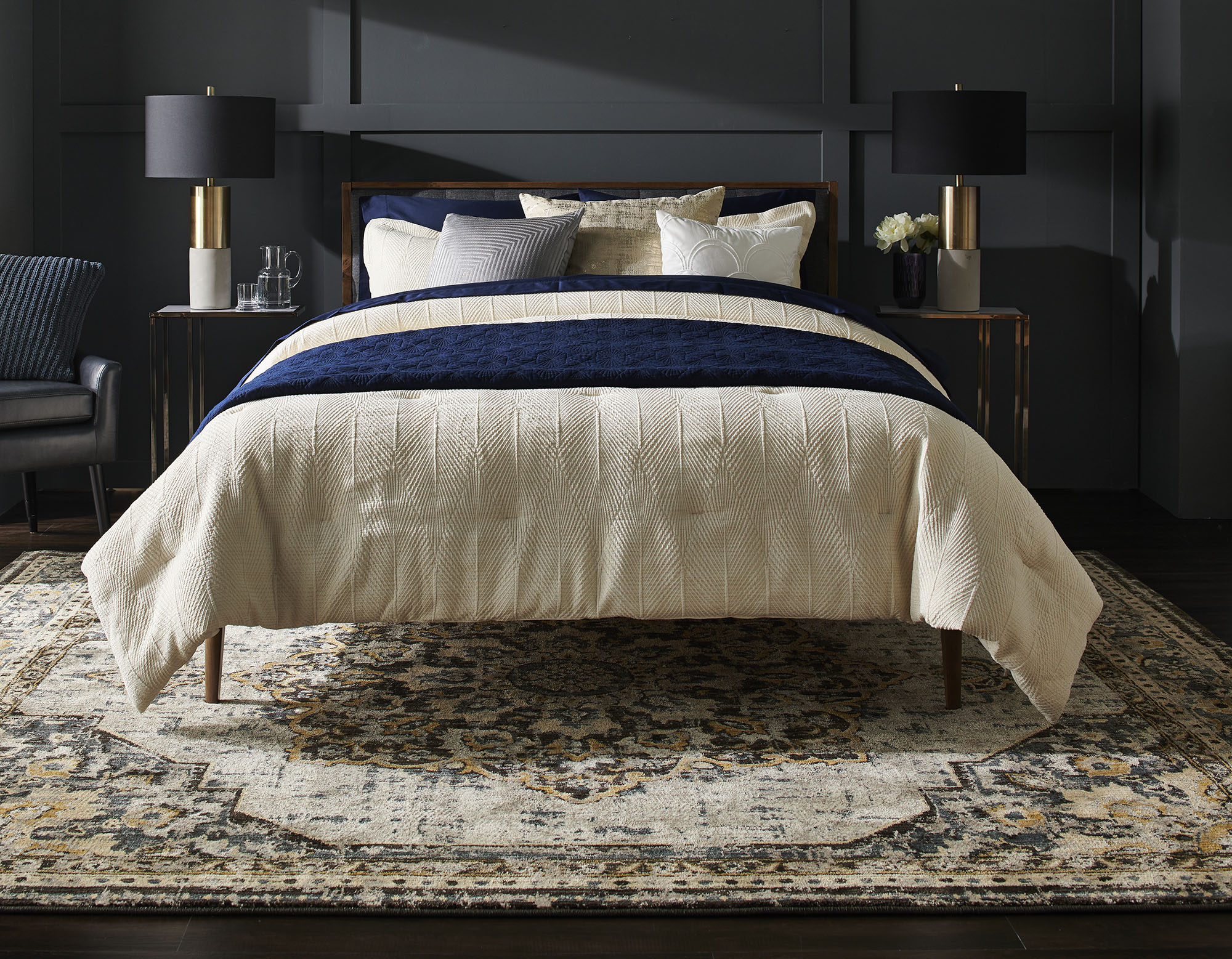 bedroom with bed, rug, and dark walls