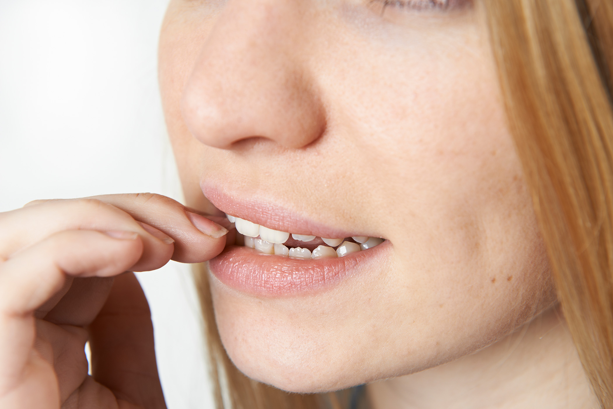 Close Up Of Nervous Woman Biting Nails