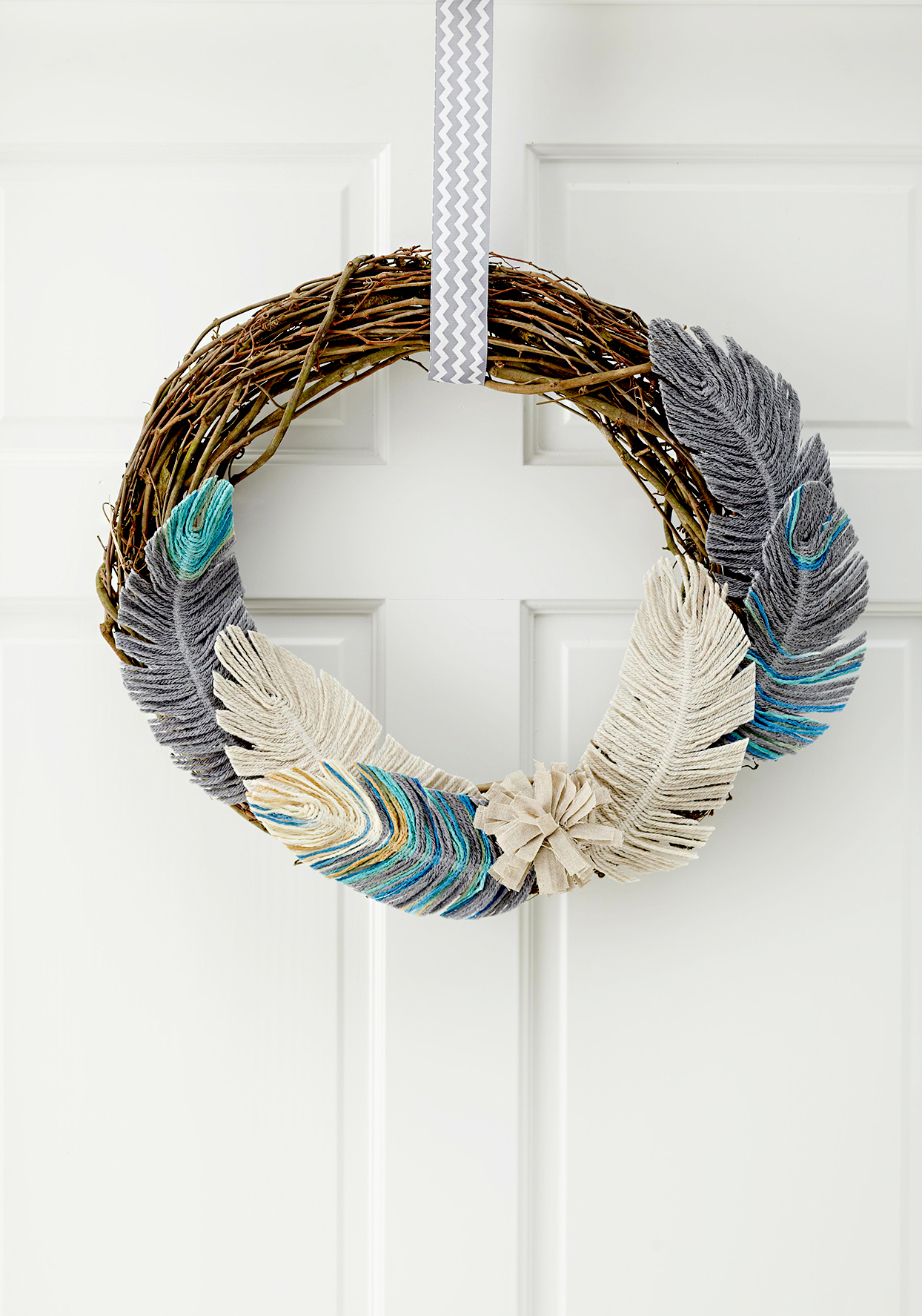 Wreath made of branches and feathers