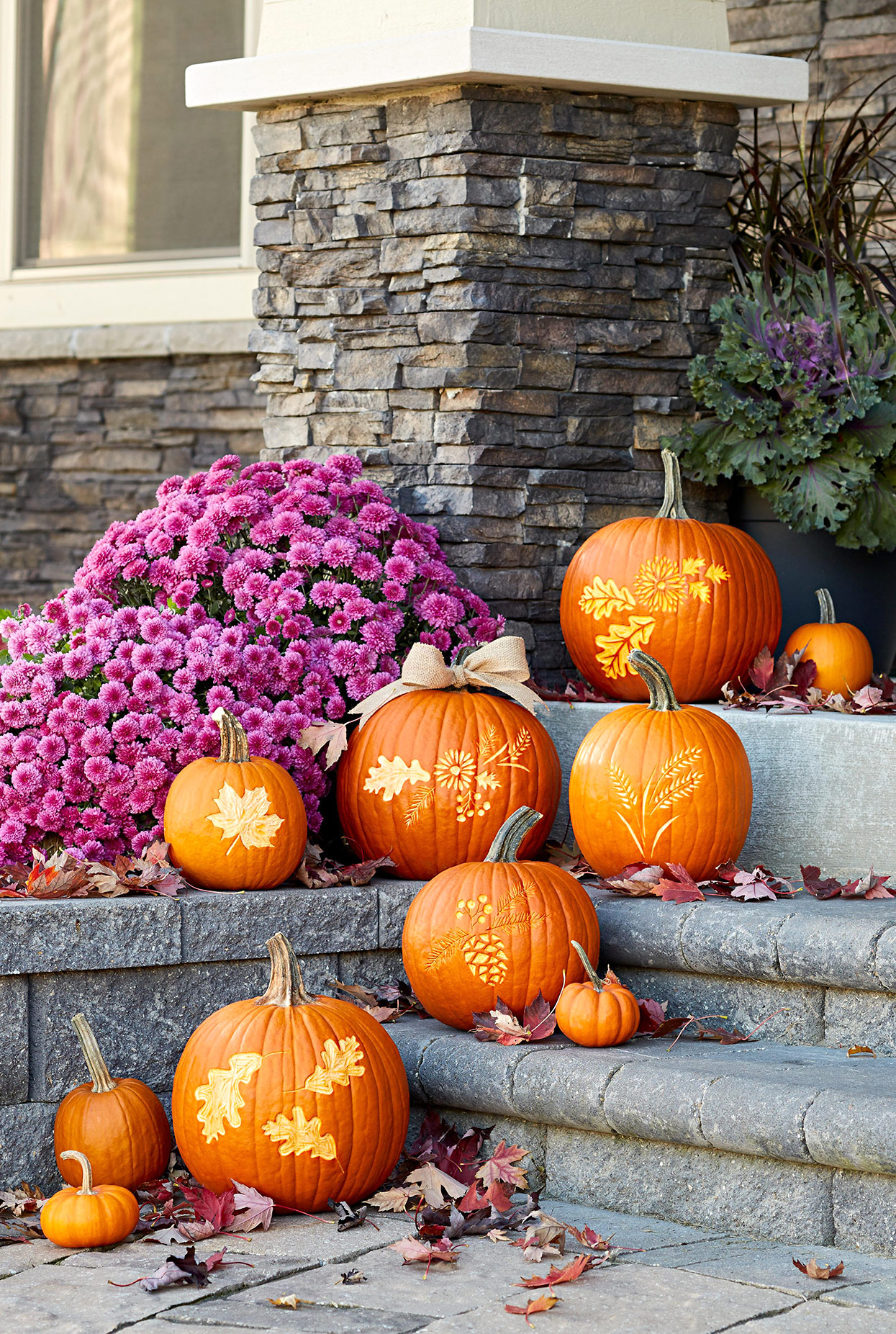 front steps with etched autumnal pumpkins