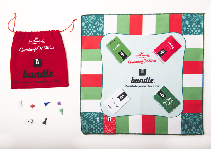 red white and green cloth board game next to a red drawstring bag with game pieces