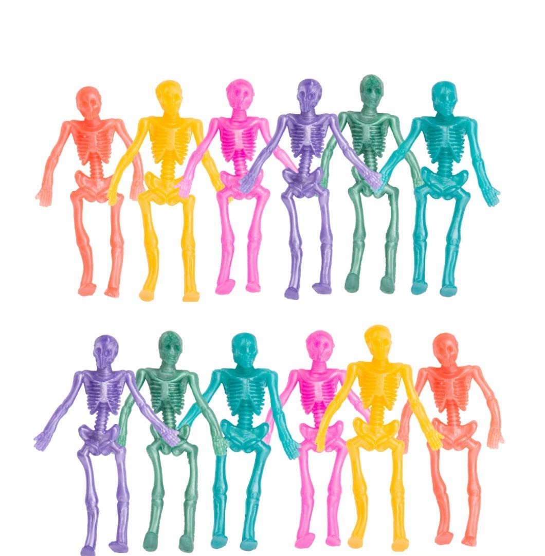 twelve multi colored plastic skeletons on a white background